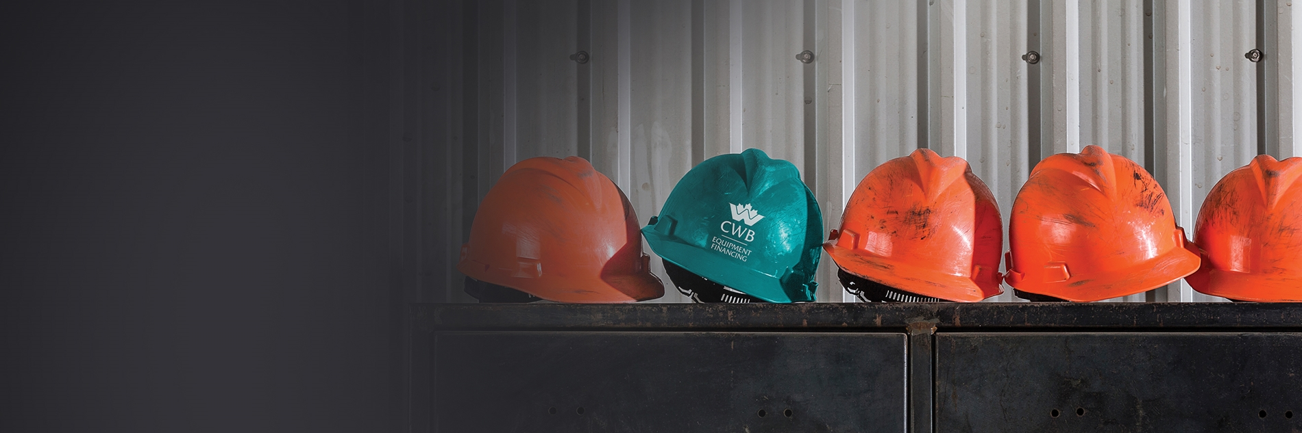 Teal CWB Hard Hat amongst orange hard hats